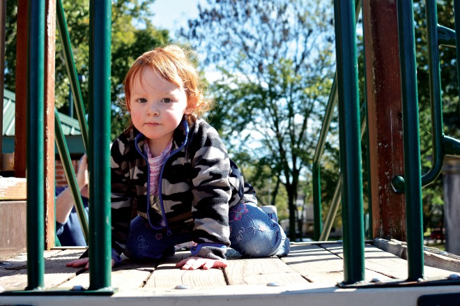 Ryley Rector, 2, crawls around the playground Thursday at College Park.